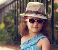 Modern kid girl in fashion glasses and hat Stock Photography