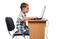 Modern kid at the laptop Royalty Free Stock Photos