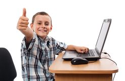 Modern kid at the laptop Stock Photos