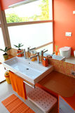 Modern kids bathroom. In orange color and mosaic tiles Stock Photography