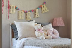 Modern kids room with doll and pillows Royalty Free Stock Image