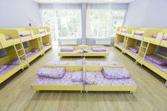 Modern kindergarten bedroom with small beds Stock Photo