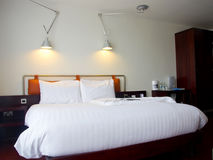 Modern king-size bed with lamps. Modern king-size bed with bedside table and lamps Stock Images
