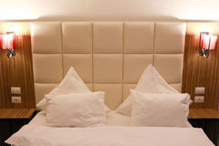 Modern king-size bed with lamps Stock Images