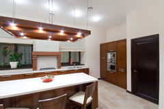 Modern kitchen. Interior to  in brown tone Royalty Free Stock Photo