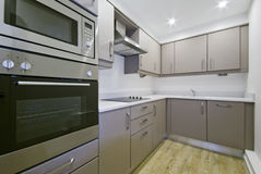 Modern kitchen. Modern luxury kitchen with hard wood floor stock photo