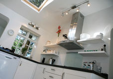 Modern Kitchen. Light modern kitchen with integrated appliances Royalty Free Stock Photography