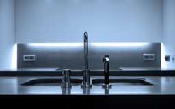 Modern kitchen. With focus on tap and double sinks Stock Images