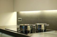 Modern kitchen. Modern design kitchen with ceramic cooking plate Royalty Free Stock Photo