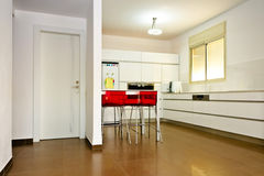 Modern kitchen. With a red chairs Royalty Free Stock Photography