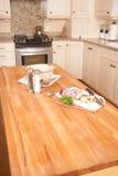 Modern Kitchen. Preparing vegetables on butcher block kitchen island stock photo