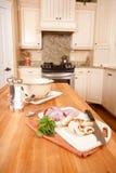 Modern Kitchen. Preparing vegetables on butcher block kitchen island royalty free stock image