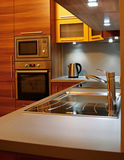 Modern kitchen. Small modern kitchen in a flat royalty free stock images
