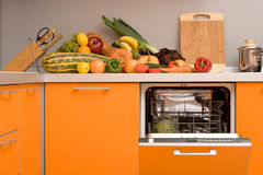 Modern kitchen. And fresh vegetables and fruits on the table Royalty Free Stock Photos