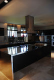 Modern Kitchen ....... A modern kitchen with stainless appliances and granite counters Royalty Free Stock Photo
