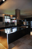 Modern Kitchen ....... A modern kitchen with stainless appliances and granite counters Stock Images
