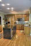 Modern Kitchen. Luxury modern kitchen with wooden cabinets and hardwood flooring Stock Images