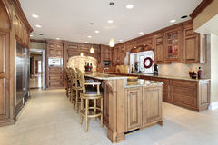 Modern kitchen. Wood cabinet kitchen with large island and arch stove Stock Photo