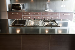 Modern kitchen in an apartment. Close up of a stove couter in interior desing of a modern kitchen in a new apartment Stock Images
