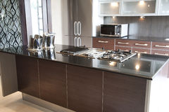 Modern kitchen in an apartment Royalty Free Stock Images