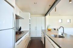 Modern kitchen. A modern kitchen with appliances stock photos