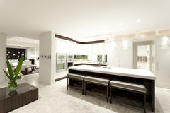 Modern kitchen with a big island stock photos
