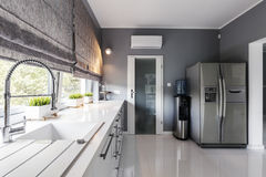 Modern kitchen with big windows royalty free stock photography