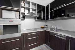 Modern kitchen in black and wenge colors Stock Image