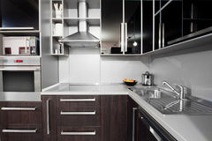 Modern kitchen in black and wenge colors Royalty Free Stock Photography