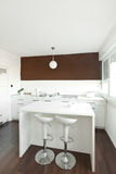 Modern kitchen with brown wall Stock Photography