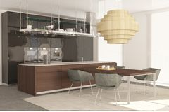 Modern kitchen cabinet with dining area.  Royalty Free Stock Image