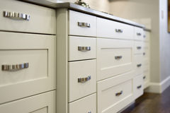 Modern Kitchen Cabinets. In a newly built home stock image