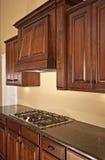 Modern Kitchen Cabinets Range Hood. Modern home with lovely custom kitchen cabinets and range hood Stock Photo