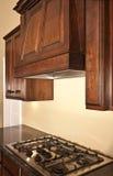 Modern Kitchen Cabinets Range Hood. Modern home with lovely custom kitchen cabinets and range hood Royalty Free Stock Photo