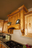 Modern Kitchen Cabinets Range Hood. Modern home with lovely custom kitchen cabinets and range hood Stock Image