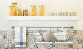 Modern kitchen with ceramic kitchenware and utensils on shel. Modern kitchen with ceramic kitchenware and utensils on the shelf Stock Photos