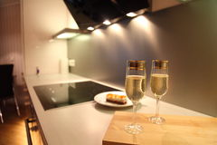 Modern kitchen and champagne Stock Photography