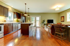 Modern kitchen with cherry floor and living room.. Modern new brown kitchen with cherry floor and living room Stock Photos