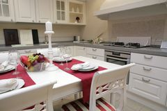 Modern kitchen in classical style Stock Photos