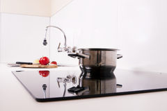 Modern kitchen; cook the induction cooker. Royalty Free Stock Image