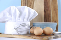 Modern kitchen cooking kitchenware and chef's hat -closeup. Stock Images