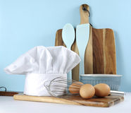 Modern kitchen cooking kitchenware and chefs hat  Royalty Free Stock Images