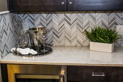 Modern Kitchen Counter With Backsplash. Plant And Ice Bucket With Glasses royalty free stock photo