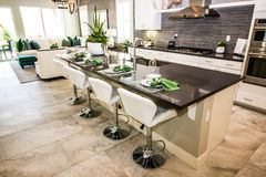 Modern Kitchen With Counter Bar & Stools. Modern Kitchen With Marble Counter Bar Island And Bar Stools royalty free stock photo