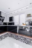 Modern kitchen countertop. Black glossy modern kitchen countertop with sink royalty free stock photos