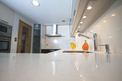 Modern kitchen with cream. And chocolate cupboards and inox hood Stock Image