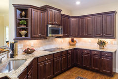 Modern Kitchen with Dark Cabinets and Wood Floor Stock Photos