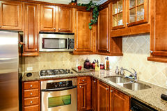 Modern Kitchen with Dark Wood Cabinets Stock Photo