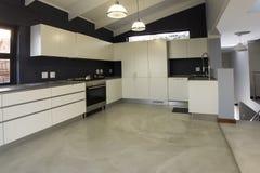 Modern kitchen design cupboards. A modern kitchen in new home Stock Image