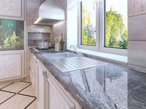 Modern kitchen design. Ecru colored cabinets. Royalty Free Stock Photography